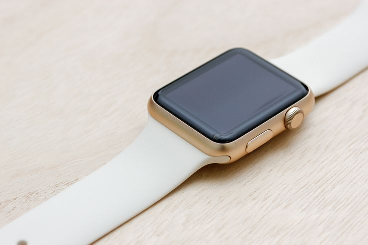 Apple Watch Sport Gold Case with Antique White Sport Band.