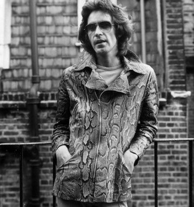 Ossie Clark, 1970, in iconic python-skinned jacket he designed.