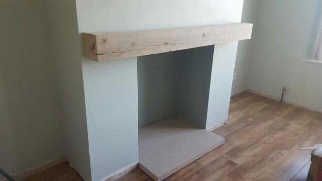 Floating oak mantel installed  Walls in farrow and ball cromarty and inside the chimney breast is pigeon with gritstone hearth.