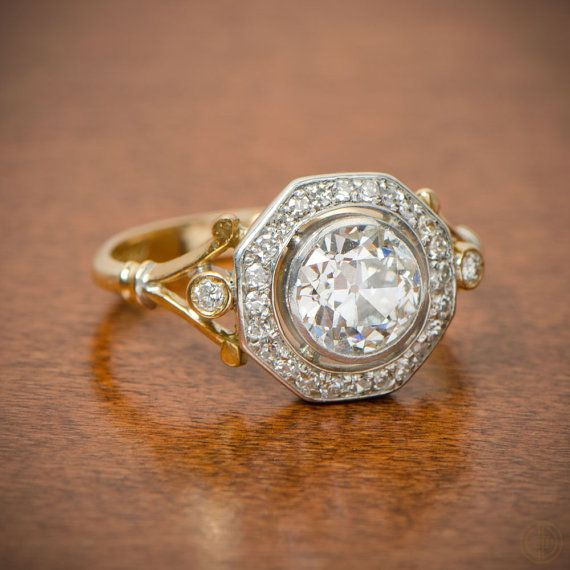 A transitional antique Edwardian engagement that depicts both silver and gold, centering an Old Mine cut diamond weighing 1.37ct, H color,