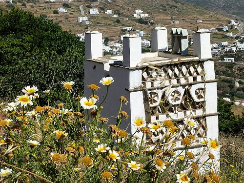 #dovecote and daisies. Tarambados, #Tinos #Cyclades #Greece #travel #ttot #travelling2gr #visitgreece  PHOTO via: Marite2007 http://www.flickr.com/photos/marite2008/4920681271/