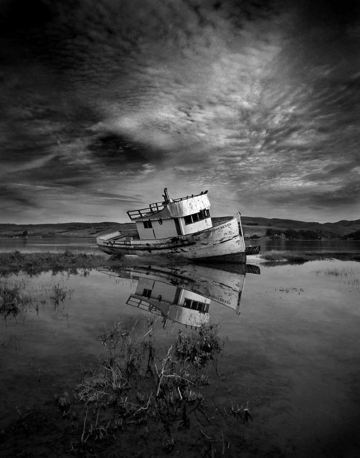 old abandoned boat black and white photograph