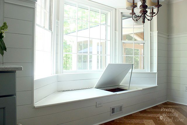 A diy window set for bay window Can store stuff inside (one_side_open_window_seat_storage) From pretttyhandygirl.com