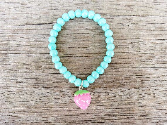 Pink Strawberry!   Beautiful pink strawberry bracelet for little cuties. This cute bracelet is made with acrylic beads in green mint color adorned with