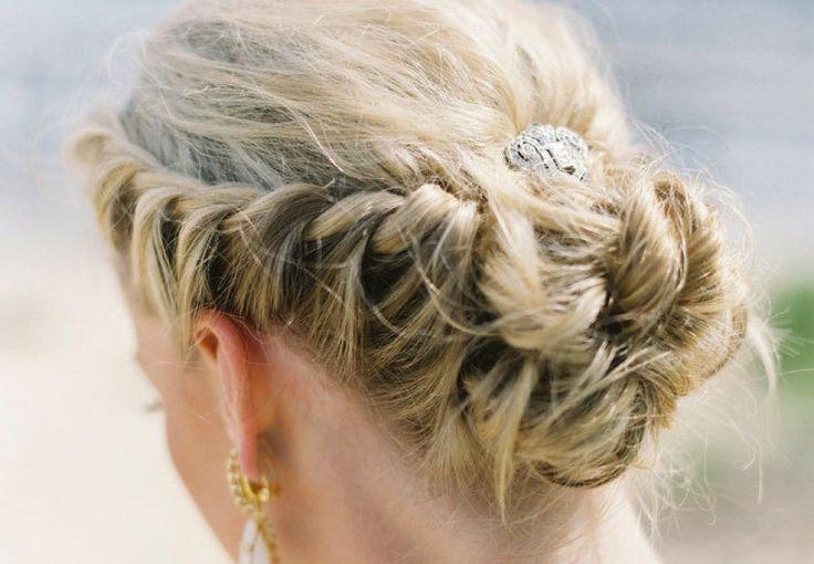 Regal wedding updo braided with rhinestone clip