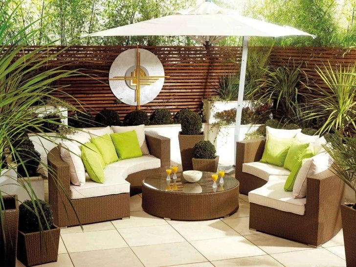 Furniture: Green Cushions White Cushions On Brown Rattan Large Sofa With Round Glass Top Table Rattan Material White Square Floor White Large Umbrella Brown Natural Wooden Hedge Green Plant Surround: Superb Outdoor Furniture in Beautiful Place