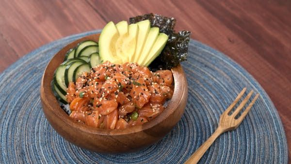 Recipe with video instructions: Satisfy your sushi craving with this twist on a Hawaiian-inspired salmon poké bowl. It's refreshing, comforting, and incredibly delicious! Ingredients: For the rice:, 1 cup of sushi rice, 5 tablespoons rice wine vinegar, 1 teaspoon sugar, to taste, 1 teaspoon salt, to taste, Seasoned seaweed, to taste, For the fish:, 1 pound sushi-grade salmon filet cubed, 5 tablespoon low-sodium soy sauce, 2 tablespoons sesame oil, 2 tablespoons lime juice, 2 teaspoons ric...