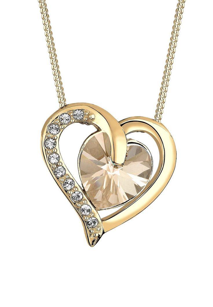 So wertvoll wie die Liebe, so schön wie seine Trägerin. Diese wunderschöne Herz-Kette wurde mit viel Liebe zum Detail aus feinstem vergoldetem 925er Sterling Silber gefertigt und mit funkelnden Kristallen von Swarovski veredelt, die ein Swarovski Kristall Herz umschließen. Ausdrucksstark und luxuriös ziert das Schmuckstück dein Dekolleté. Lege mit dieser wunderschönen Herzkette einen glänzenden...