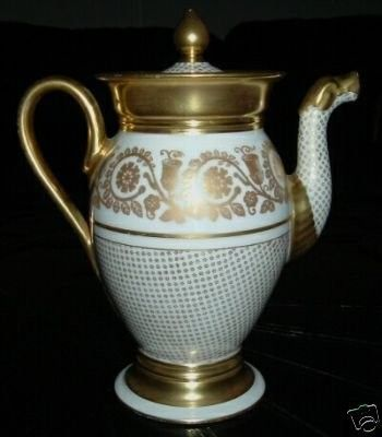 Elegant T &V Antique Limoges Heavy Gold Gilded Teapot I recently found this stunning lavishly gold gilded tea/coffee pot at an estate sale in my neighborhood. It is hand decorated with gold scrolls a
