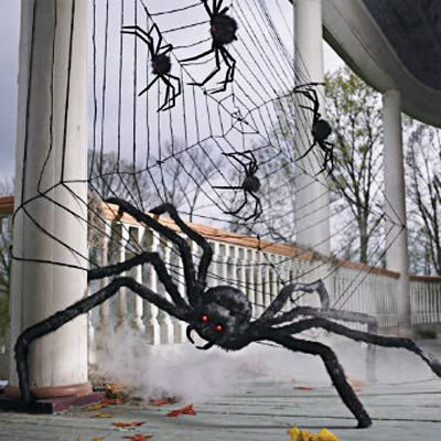 oversized faux fuzzy spiders and webs for the front porch for Halloween
