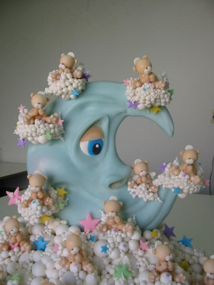 One of the cutest cakes I have seen with little teddy bears floating on clouds about a blue crescent moon.