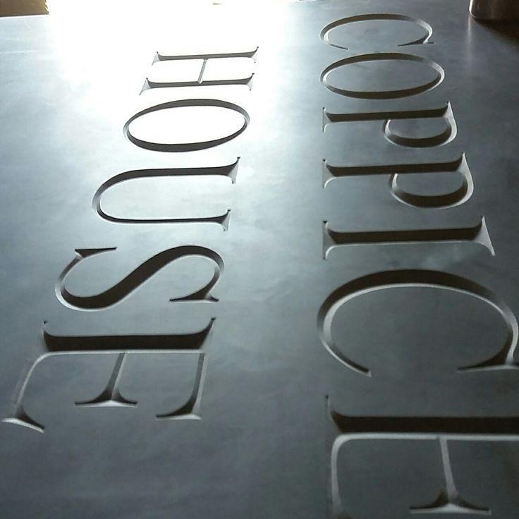 Deep V cut lettering into welsh slate. House sign By Dan Anderson www.bespokelettercutting.co.uk