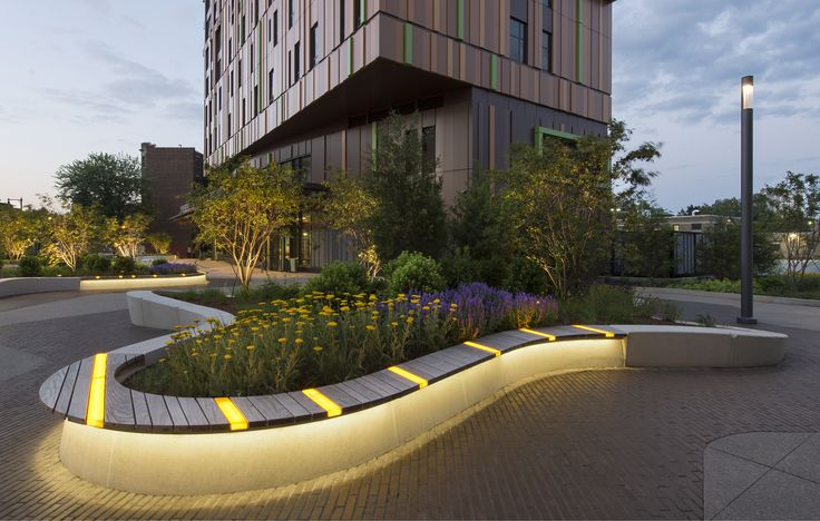 At the base of a new residence hall built for Boston's Massachusetts College of Art and Design, Ground Inc. made good use of a tight budget. Undulating raised planters with varied-height seat walls create distinct socializing areas, and illuminated benches work both as a sculptural statement and a counter to the region's cold, dark winters.