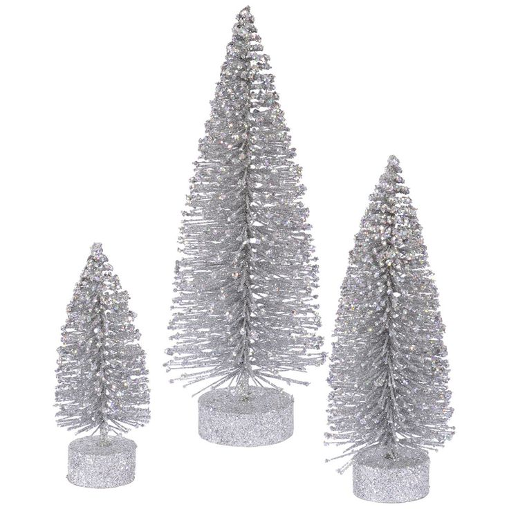 "Artificial Christmas trees each feature a silver ""snow"" glittered finish Product Features: Unlit For indoor use only Each tree stands alone so you can display them separately or in a group No assemb"