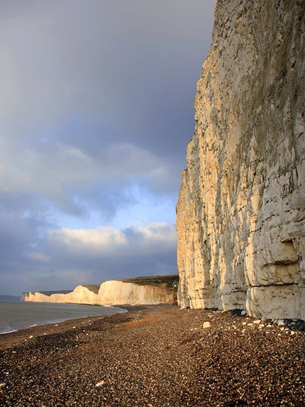 Seven Sisters chalk cliffs along the English Channel, South Downs National Park, England ~ Photograph by Dave Porter, Photolibrary