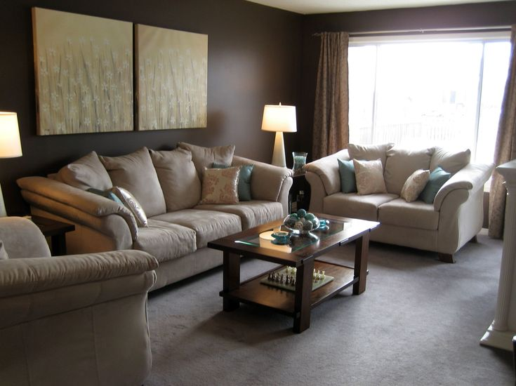 classy beige couch with small brown wooden coffee table added single tier storage also art wall on brown wall as decorate in modern small brown living room