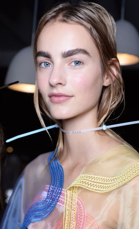 """Bushy """"feral brows"""" trended at Christopher Kane where models showcased a raw and undone beauty look by NARS. It seems bold brows are going nowhere…"""