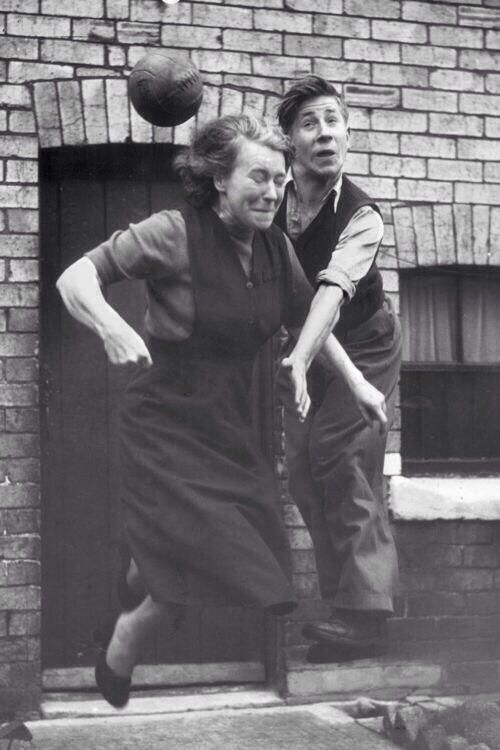 Bobby Charlton practices his heading skills with his mother Elizabeth outside their home, 1953