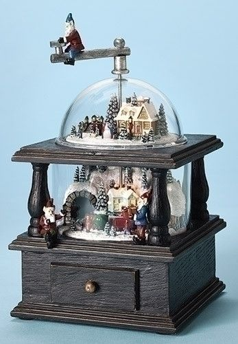 "Imagine waking up in the morning to elves operating this Old Fashioned Christmas Coffee Grinder! - LED lit music box. - Plays various Christmas songs. - 10.25"" H x 5.75"" W x 6.25"" D - Battery operated"