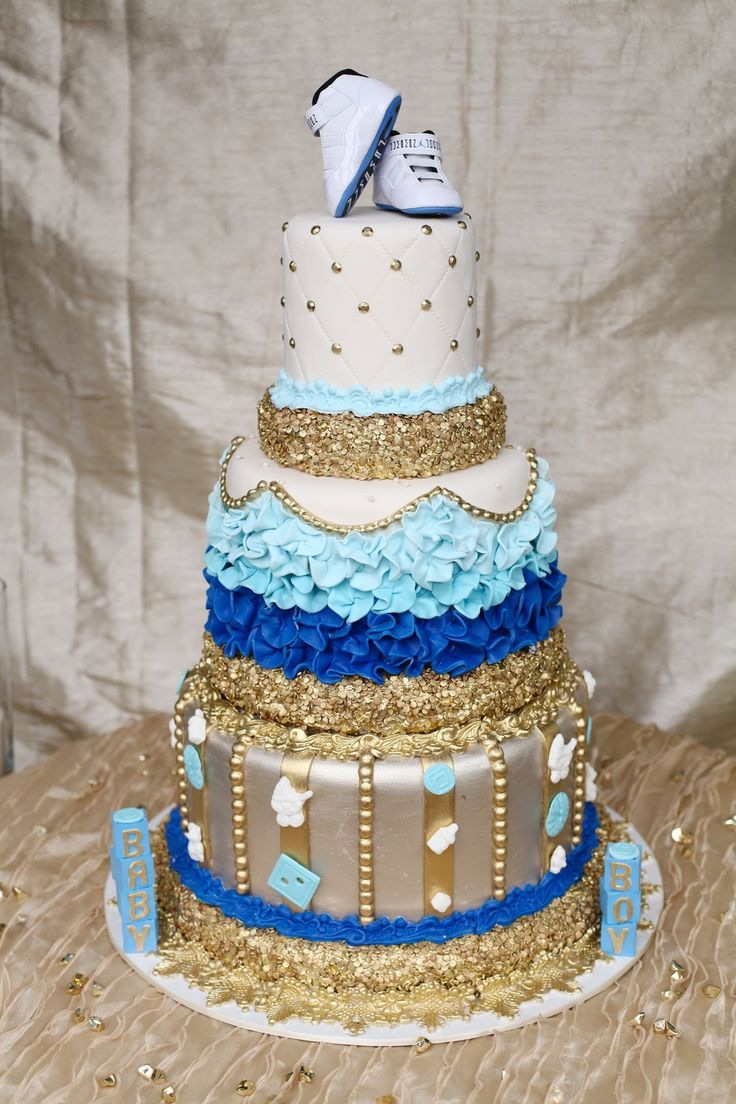 Baby Shower Cake With Baby Items Gold Blue And White