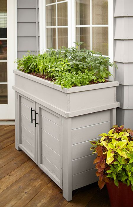 store deck patio or gardening supplies in a planter that raises greenery to a