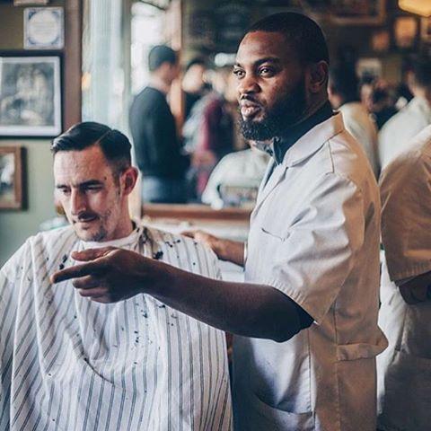 @raunchy.randy working his magic. • Photo by @nomadbarber courtesy of @schorembarbier • #barber #haircut #style #beards #beardbrand #urbanbeardsman #lifestyle #haircare #hairstyle #beard #grooming #community