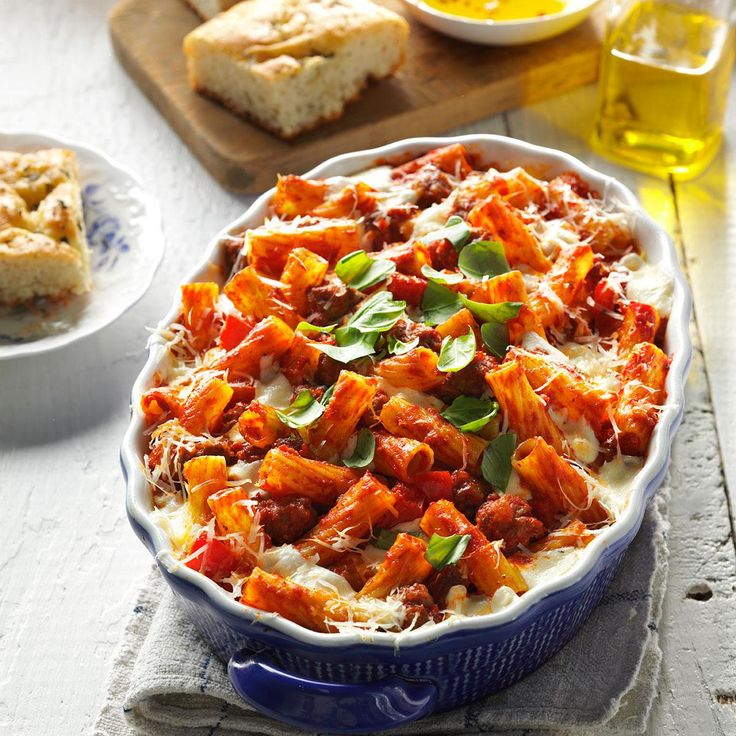 Four-Cheese Sausage Rigatoni Recipe -To make this twist on traditional baked pasta, we start with creamy goat cheese and build from there with mozzarella, ricotta and Parmesan cheese. —Teresa Ralston, New Albany, Ohio