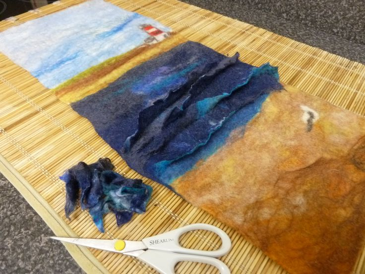 This is my latest wet-felted wallhanging: the 'waves' are getting a final trim before I roll / full the hanging for the last time.  Once dried, it will be lightly hand-embroidered and embellished.    You can see more of my work at: www.facebook.com/LittleDebFelts