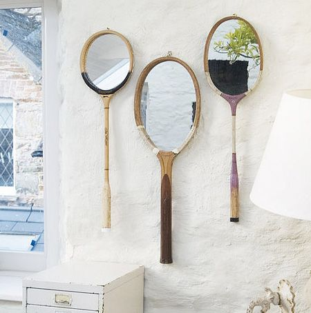 Really love this idea, using old rackets for wall mirrors.