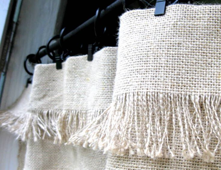 Use burlap or felt to make no-sew curtains.  Glue the side seams and duct tape the hem. I'm thinking too that this picture would be a great frayed-bottom of a curtain since burlap holds well when ironed.  Then hand-stitch in place, and even cover the stitching with ribbon or duct tape.