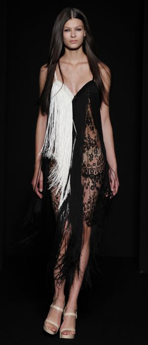 love this black and white fringed dress by Ingrid Vlasov
