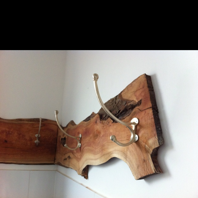 Coat rack. Made out of yew wood and silvercoated hooks.