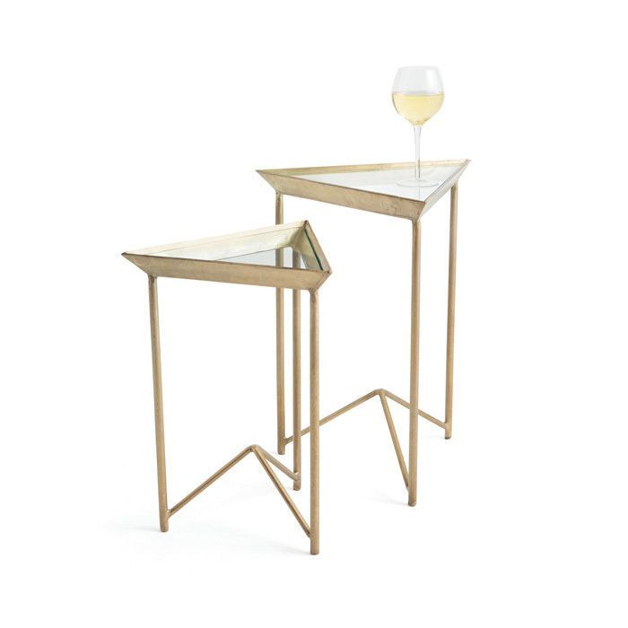 Modernize your furniture collection with this set of side tables, which nest for efficient storage when not in use. Made from iron with a brass finish, the tables feature glass tops for reflective ele