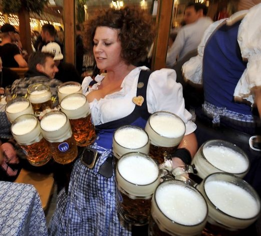 "Waitress Helga carries beer glasses in the ""Hofbraeuhaus"" beer tent at the Theresienwiese Oktoberfest fair grounds in Munich, southern Germany, on September 24, 2012. The world's biggest beer festival Oktoberfest will run until October 7, 2012. AFP PHOTO / FRANK LEONHARDT GERMANY OUTFRANK LEONHARDT/AFP/GettyImages Photo: Frank Leonhardt, AFP/Getty Images / SF"