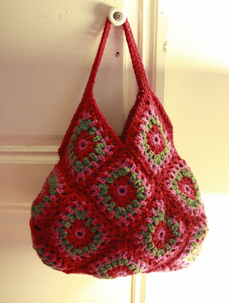 Crochet Granny Square bag - I'd want stronger handles, and perhaps a lining.  Very cute!