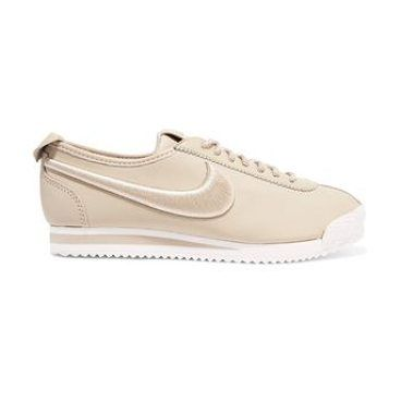 cortez 72 si embroidered leather sneakers by Nike. Sole measures approximately 30mm/ 1 inch. Sand leather. Lace-up front. Designer color: Oatmeal . Nike follows its own size conversion, therefore the size stated on the box will differ from the one provided in our conversion chart. To rec... #nike #sneakers #activewear #athleisure