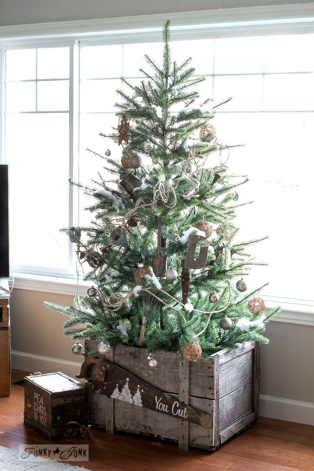 natural looking faux ikea christmas tree in an old crate decorated in metals and twine - Real Looking Christmas Trees