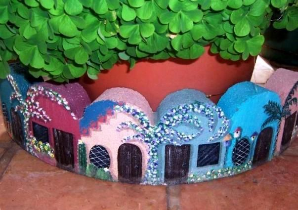 "17 Playful painting projects for the garden Becky Capps says, ""I took a concrete tree ring and made it into a village…it was more fun than I can even tell you!"""