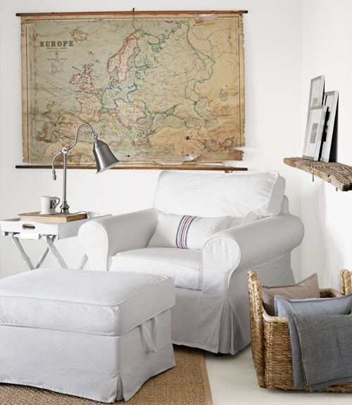 a reading chair, lamp and a vintage map of Europe who would