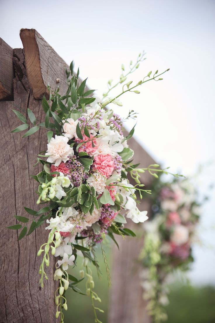 Rustic Wedding Arches | The groom created this stunning wood arch which fit in with the rustic ...