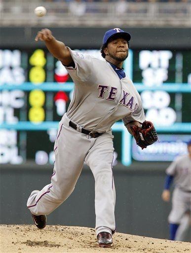 Texas Rangers starting pitcher Neftali Feliz throws against the Minnesota Twins during the first inning of a baseball game on Sunday, April 15, 2012, in Minneapolis. The players were all wearing  No. 42 in honor of Jackie Robinson Day. (AP Photo/Genevieve Ross) game 10