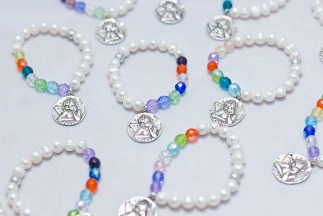 Pulseras de silicona con perlas, cristal de bohemia y medalla de angelito #pulsera #boda #bautizo #comunión #bisutería #diy @Beryllos_Gijon https://twitter.com/Beryllos_Gijon www.facebook.com/BeryllosAbalorios