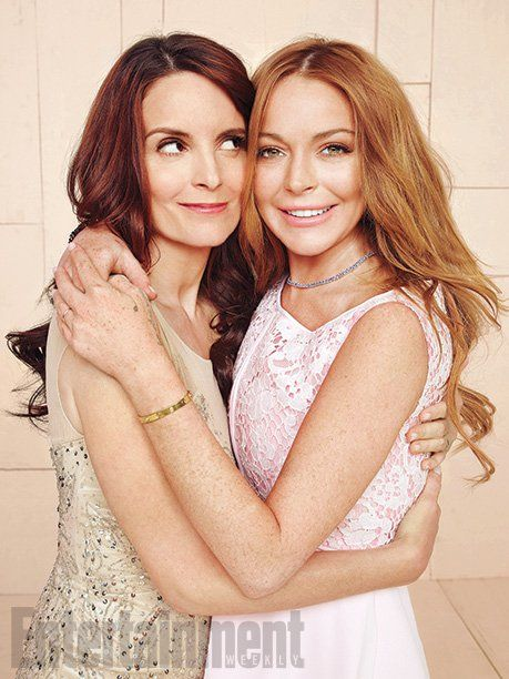 Pin for Later: Mean Girls Got a Stylish Upgrade — and It Doesn't Include Pink Sweatpants Mean Girls Style Now Tina Fey and Lindsay Lohan hug it out in Entertainment Weekly's issue.