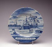 bord 'No 12. 't Kooken van de Traan.'productieplaats: Delft plateelbakkerij: De Porceleyne Byl merk: (figuratief teken van een) bijltje (achterkant) datering: circa 1750 - 1775 materiaal / techniek: faience, tinglazuur, loodglazuur (kwaart), grootvuurtechniek, monochroom (blauw) opschrift: 'No 12. 't Kooken van de Traan.' afmeting: Afmetingen algemeen: 25,2 cm herkomst: verwerving onbekend verwerving onbekend literatuur: Dutch Delftware, Including 'Facing East: Oriental Sources for Dutch…