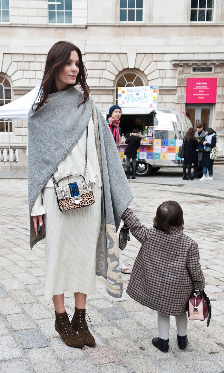 The most stylish (and adorable) street style pair during London Fashion Week Day 1. | Via IMAXTREE