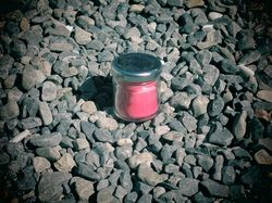 Cute mini soy travel candle made in a tiny recycled jam jar.
