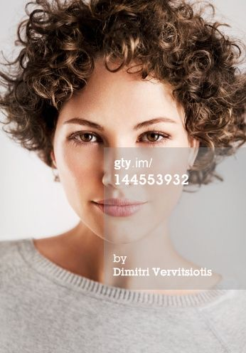 Stock-Fotografie: Beauty portrait of curly brunette woman