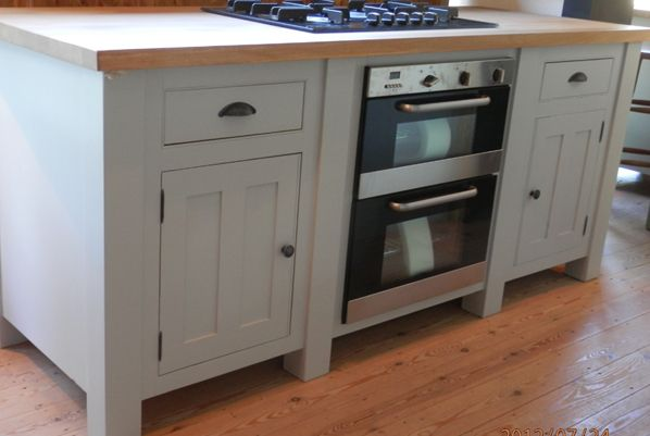 One of our solid wood kitchen islands with an integrated oven. http://www.john-willies.com/kitchens/freestanding_islandunits.php