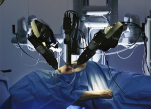Precision robot arms maneuver microsurgical instruments through centimeter-long holes into the heart of a cadaver in a demonstration of minimally invasive surgery at Intuitive Surgical of Mountain View, California.