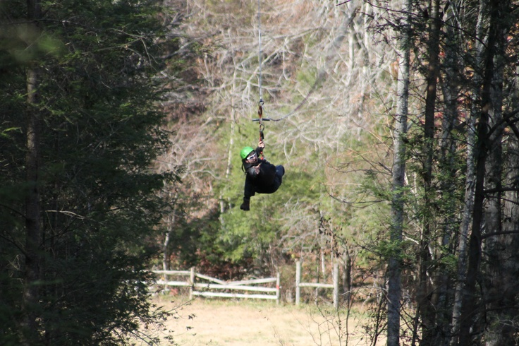 Jose flying through the air with the greatest of ease...Zip lining @FoxFire Mountain in Sevierville, TN